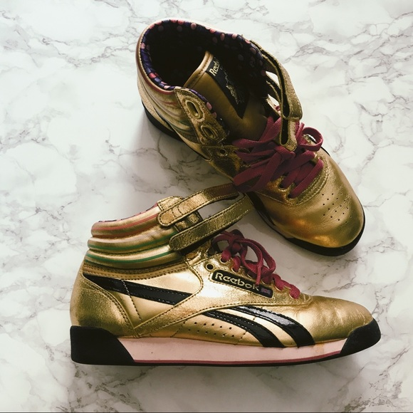8cb0491068 Reebok Shoes   Classic Freestyle Metallic Gold Hi Top   Poshmark